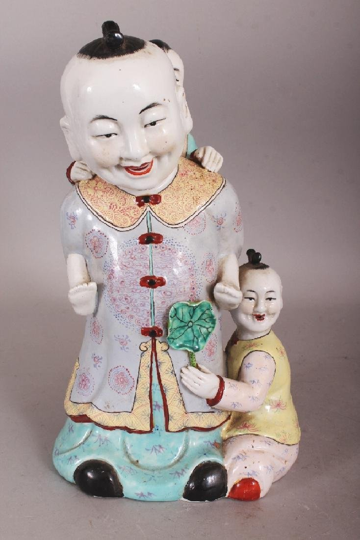A 20TH CENTURY CHINESE FAMILLE ROSE PORCELAIN GROUP,