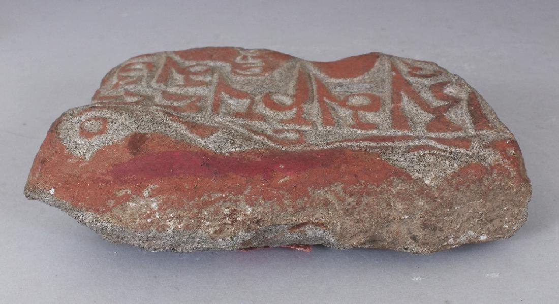 AN EASTERN SANDSTONE CARVED FRAGMENT, decorated in - 2