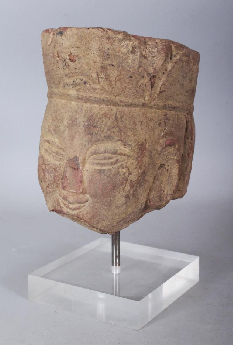 A CHINESE SANDSTONE HEAD OF A BODHISATTVA, modelled in