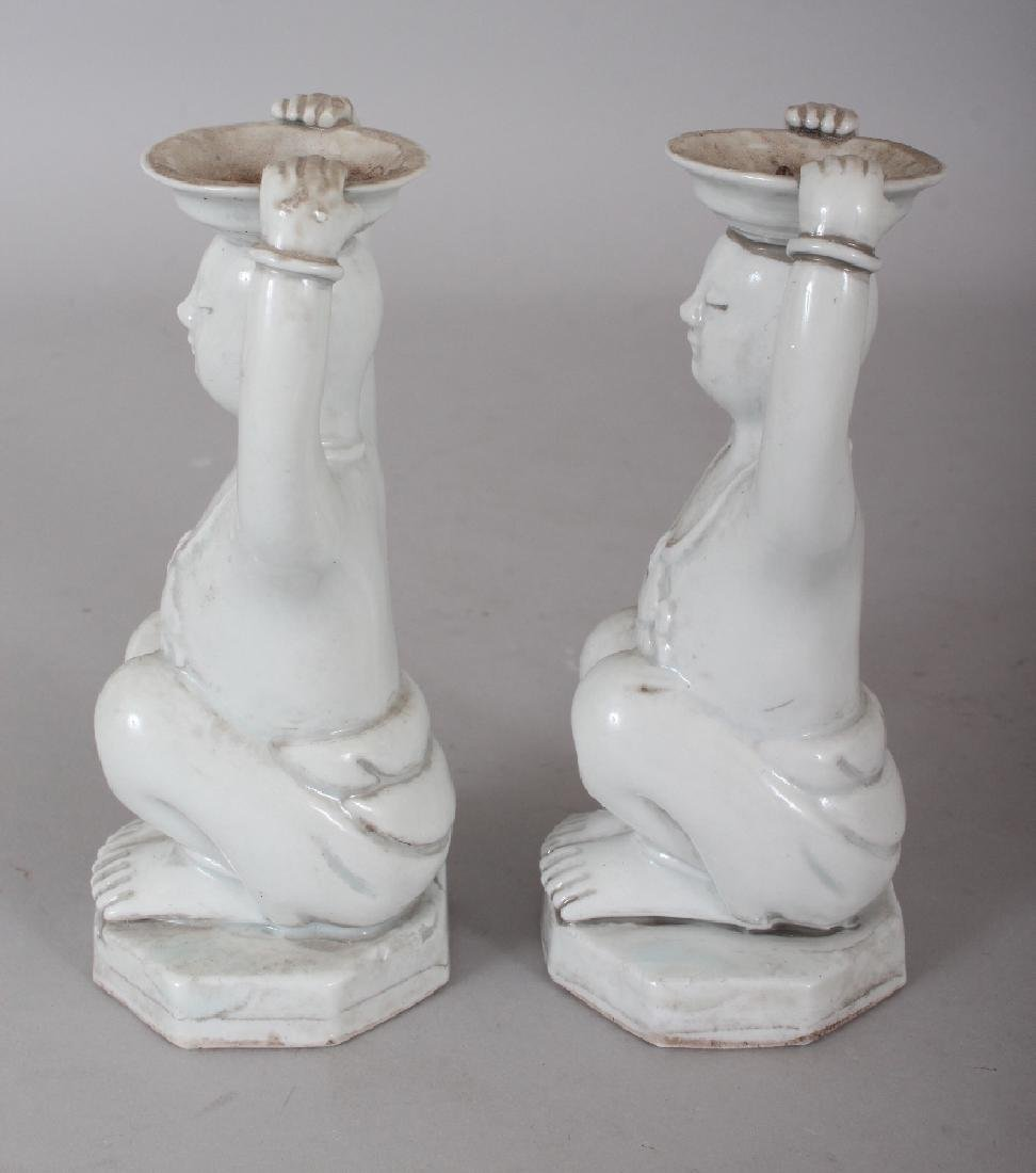 A PAIR OF CHINESE WHITE GLAZED PORCELAIN CANDLESTICKS, - 2