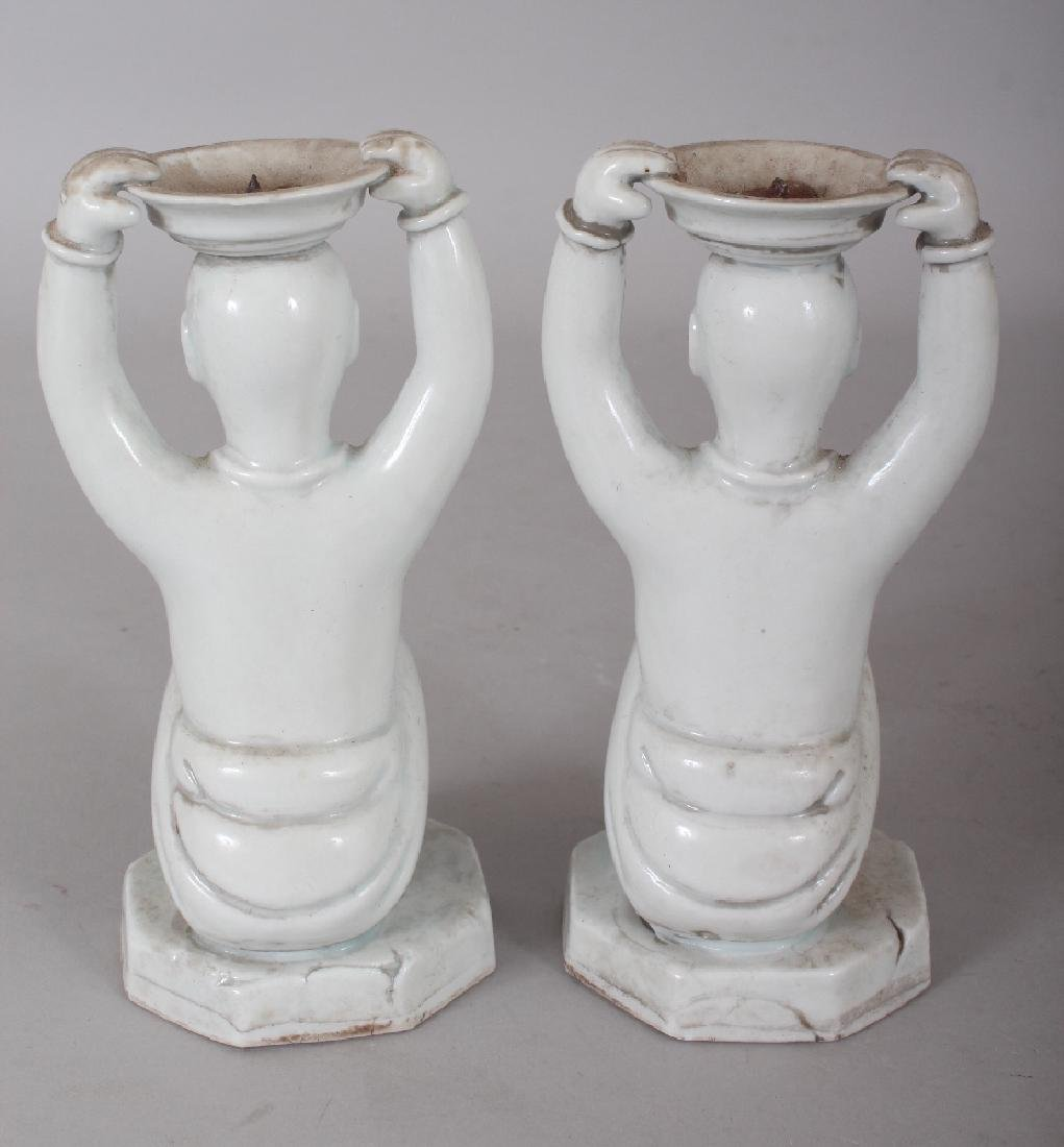 A PAIR OF CHINESE WHITE GLAZED PORCELAIN CANDLESTICKS, - 3