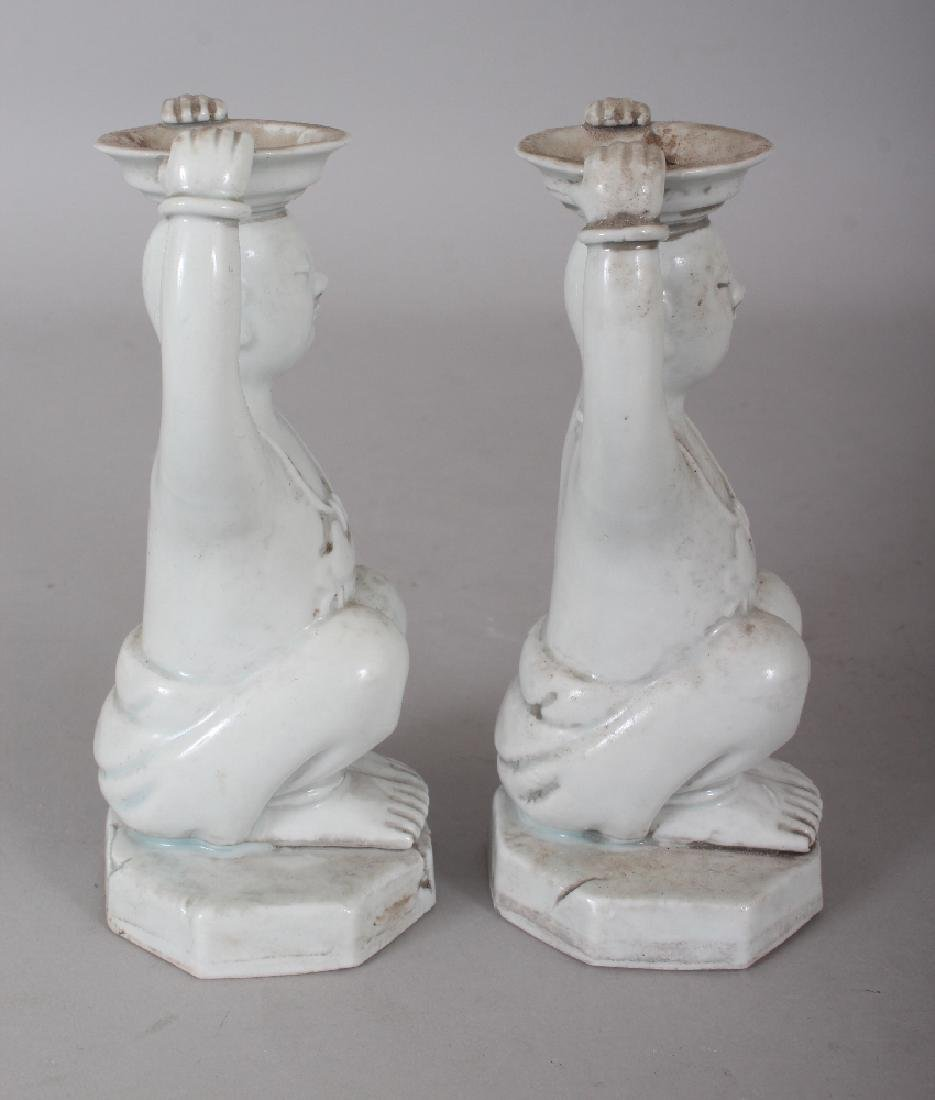 A PAIR OF CHINESE WHITE GLAZED PORCELAIN CANDLESTICKS, - 4