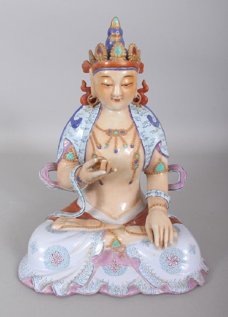 A CHINESE FAMILLE ROSE PORCELAIN FIGURE OF BUDDHA,