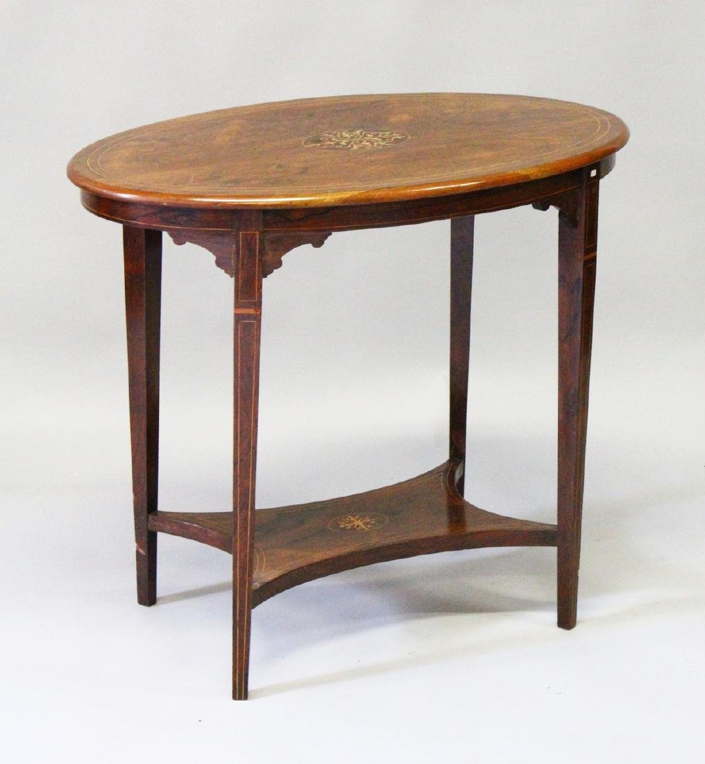 AN EDWARDIAN MAHOGANY INLAID OVAL TABLE with curving