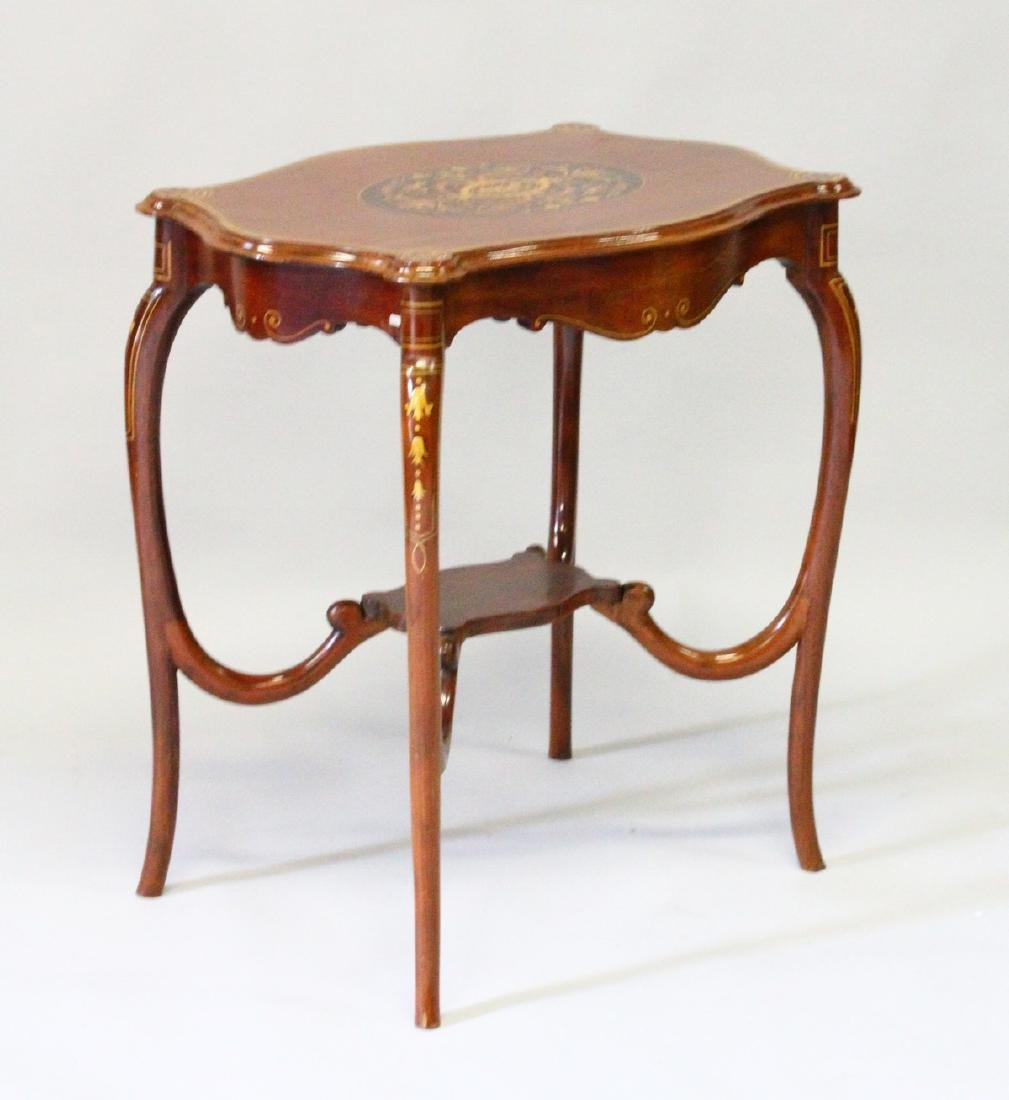 AN EDWARDIAN MAHOGANY INLAID SHAPED RECTANGULAR TABLE