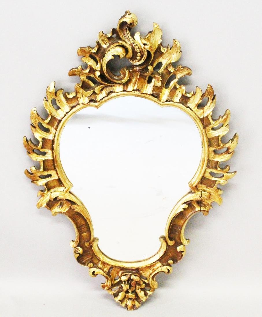 AN 18TH-19TH CENTURY ITALIAN CARVED AND GILDED SHAPED
