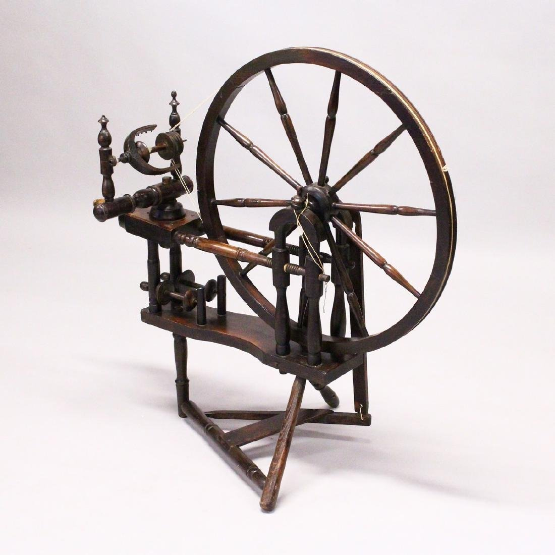 A COTTAGE SPINNING WHEEL.