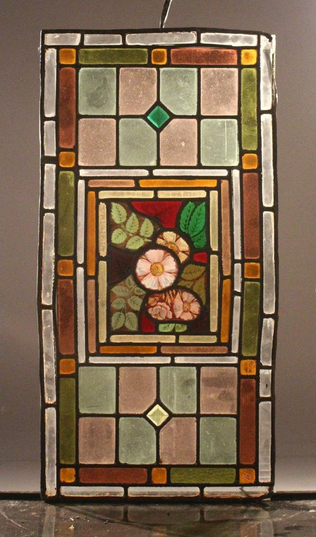 A PAIR OF 19TH CENTURY STAINED GLASS WINDOW PANELS, the