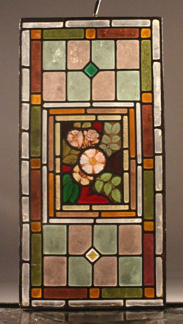 A PAIR OF 19TH CENTURY STAINED GLASS WINDOW PANELS, the - 2