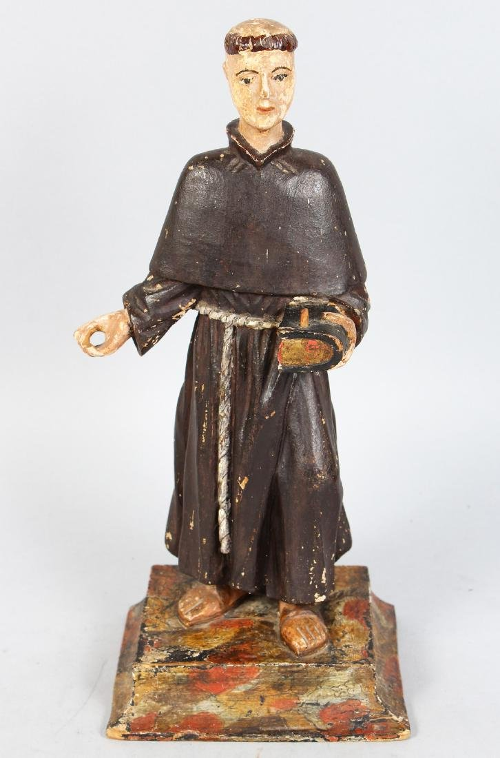 AN EARLY 17TH-18TH CENTURY CARVED AND PAINTED STANDING