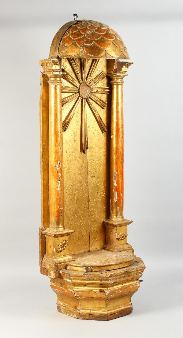 AN 18TH-19TH CENTURY CARVED AND GILDED SHRINE.  44ins