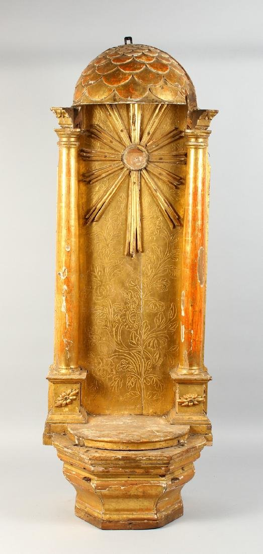 AN 18TH-19TH CENTURY CARVED AND GILDED SHRINE.  44ins - 3