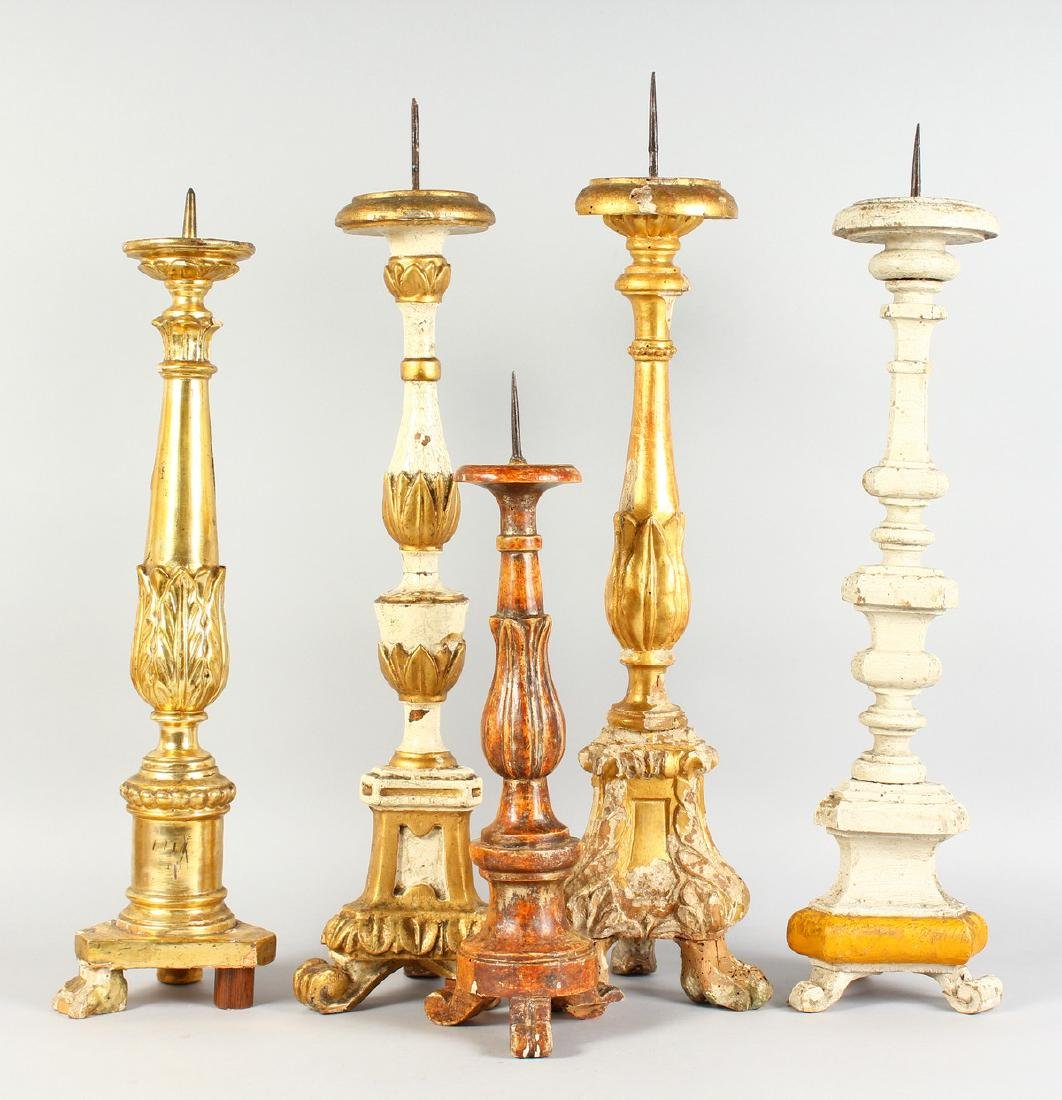FIVE VARIOUS ITALIAN CARVED AND GILDED PRICKET