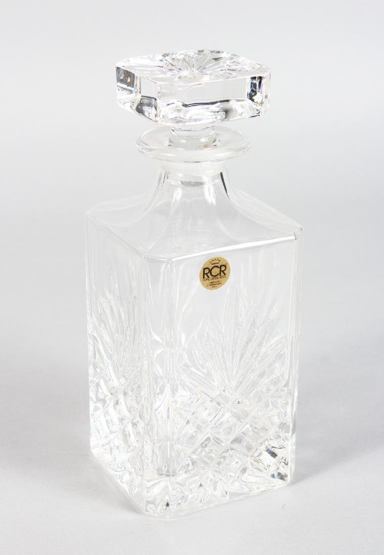 A ROYAL CRYSTAL CUT GLASS WHISKY DECANTER AND STOPPER.