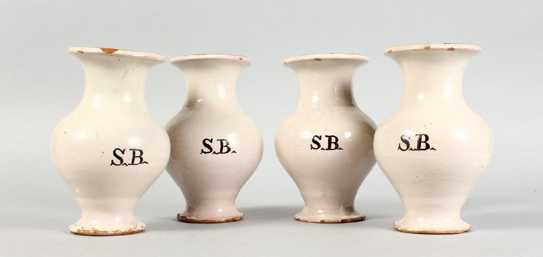 A SET OF FOUR ITALIAN POTTERY VASES.  7ins high.