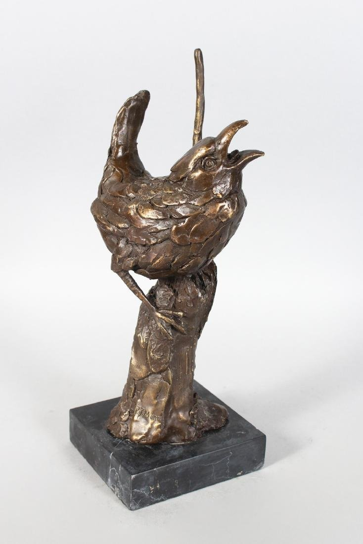 A BRONZE STUDY OF A BIRD ON A BRANCH.  On a marble