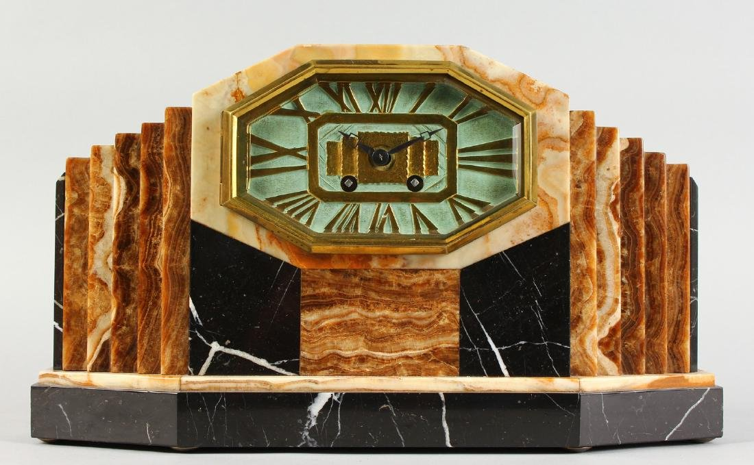 A 1920'S ART DECO MANTLE CLOCK with various coloured