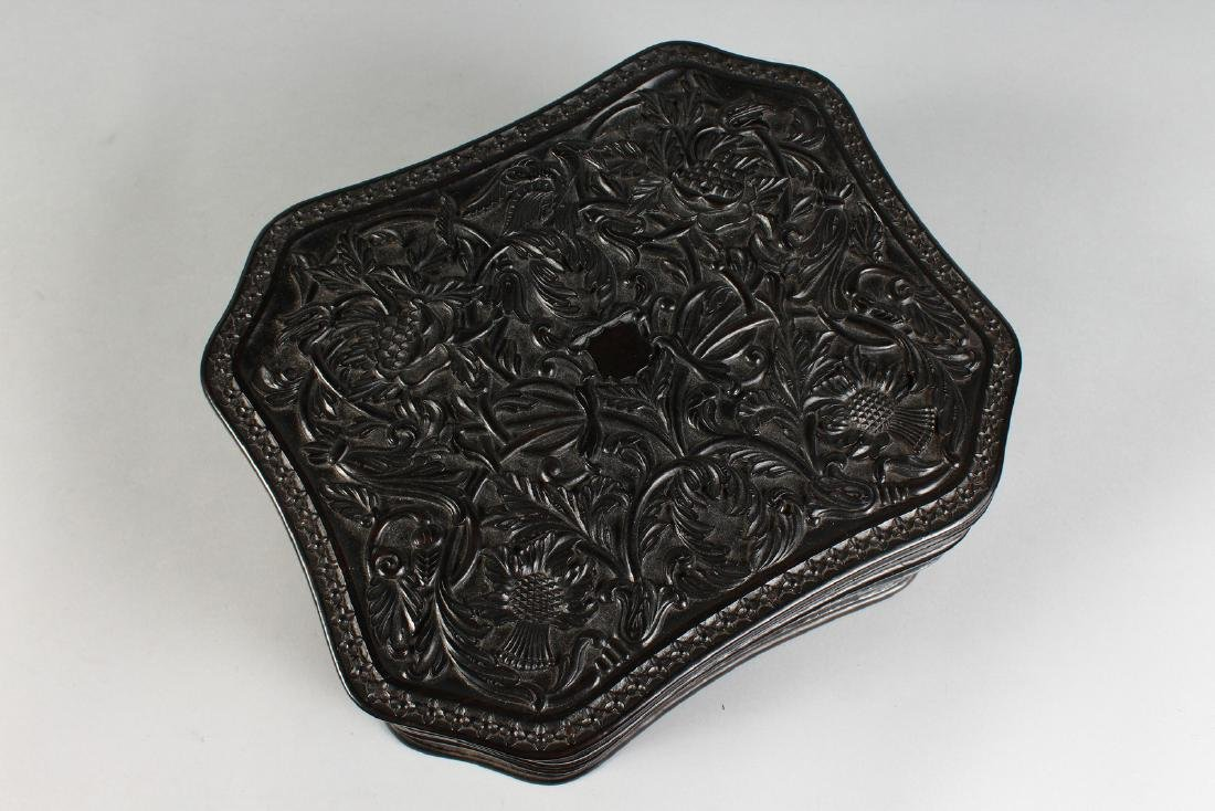 A GOOD ANGLO INDIAN CARVED EBONY BOX.  1ft long. - 2