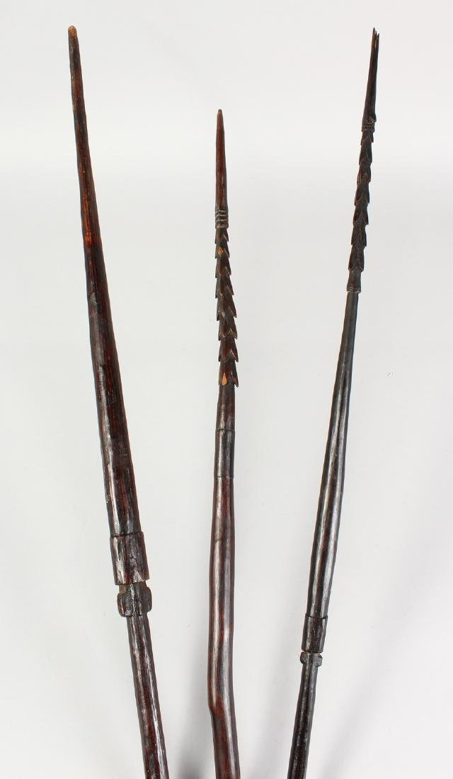 THREE PAPUA NEW GUINEA CARVED BARBED SPEARS,