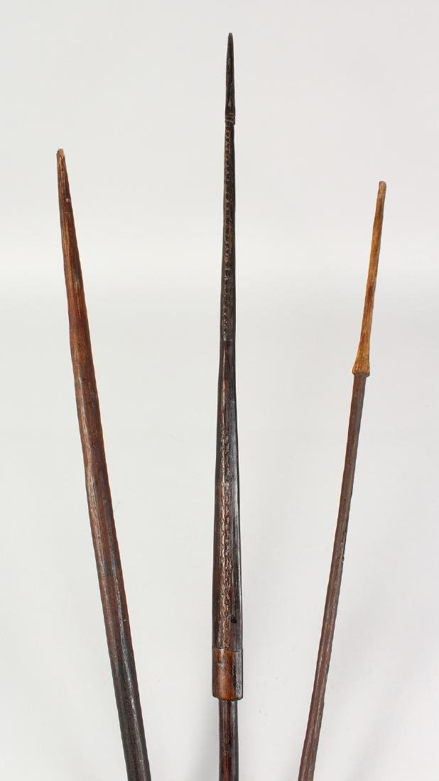 THREE PAPUA NEW GUINEA CARVED BARBED SPEARS.  Longest: