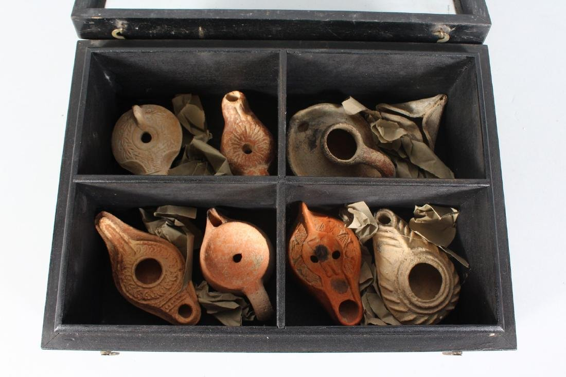 A COLLECTION OF ROMAN TERRACOTTA OIL LAMPS, housed in a - 3