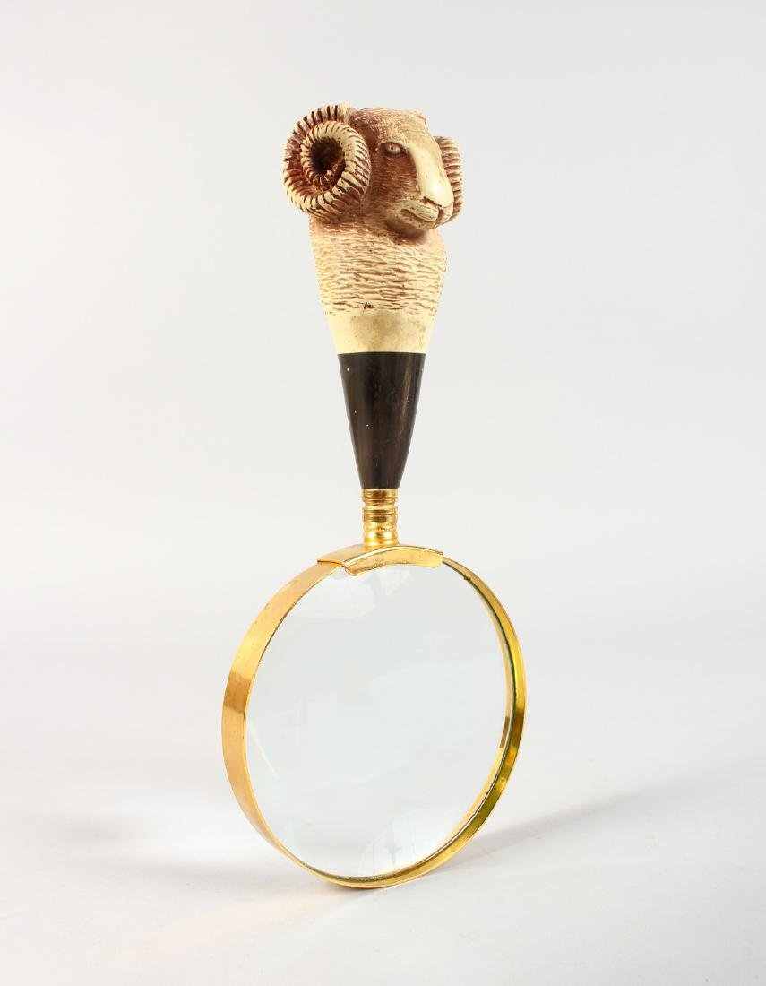 A RAMS HEAD MAGNIFYING GLASS.