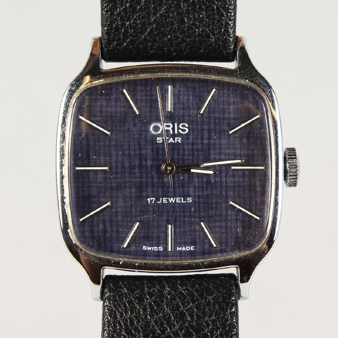 AN ORIS WRISTWATCH with leather strap.