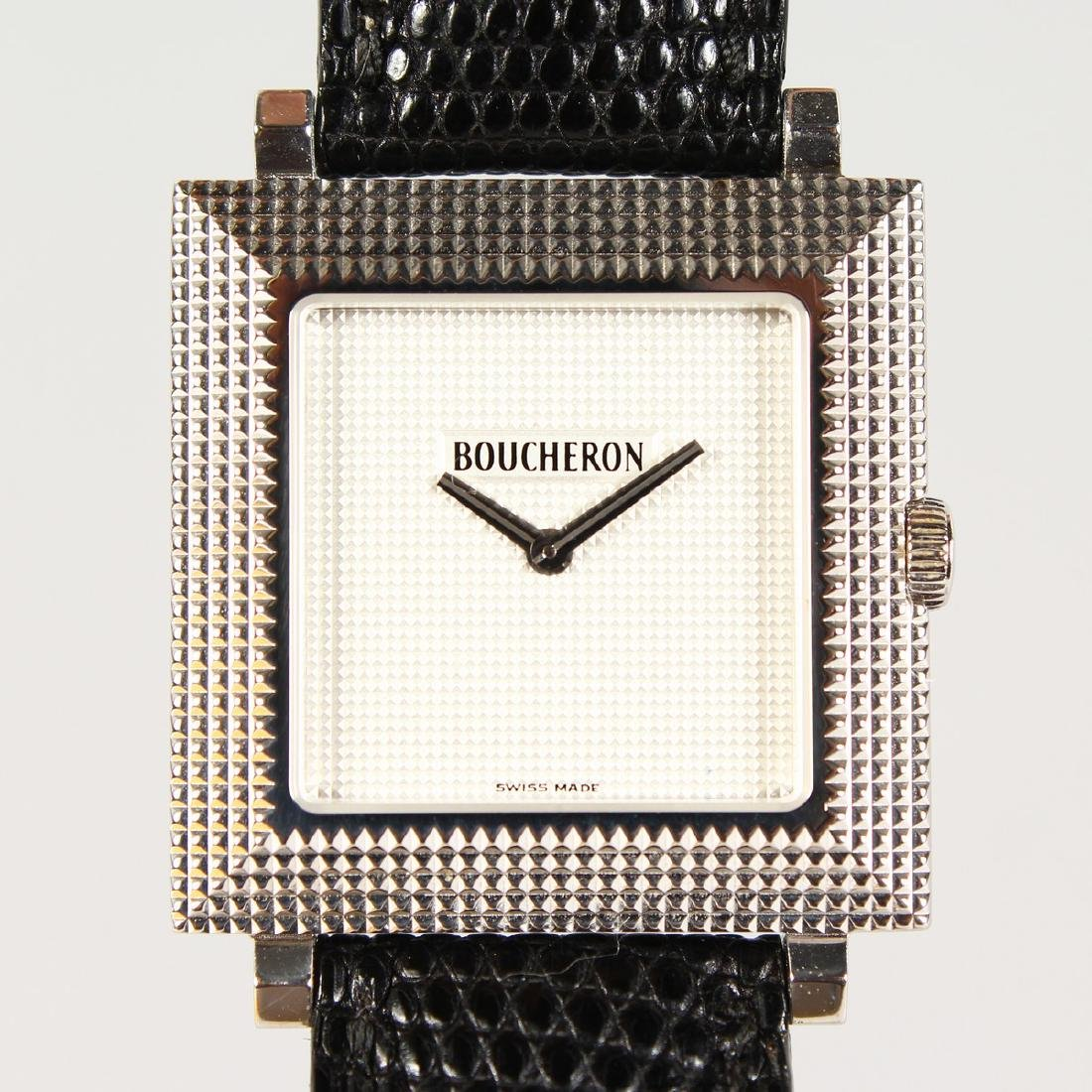 AN 18CT GOLD BOUCHERON WRISTWATCH, with leather strap,