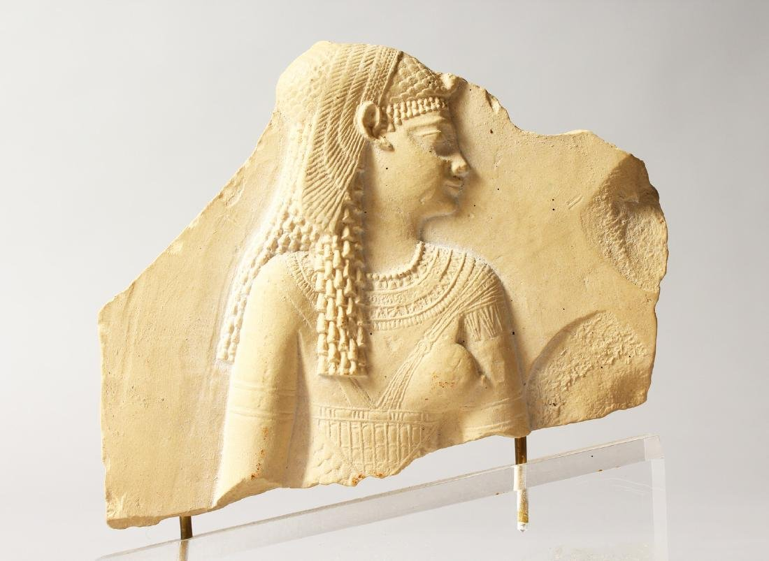 A MUSEUM COPY EGYPTIAN FRAGMENT on a Perspex base.