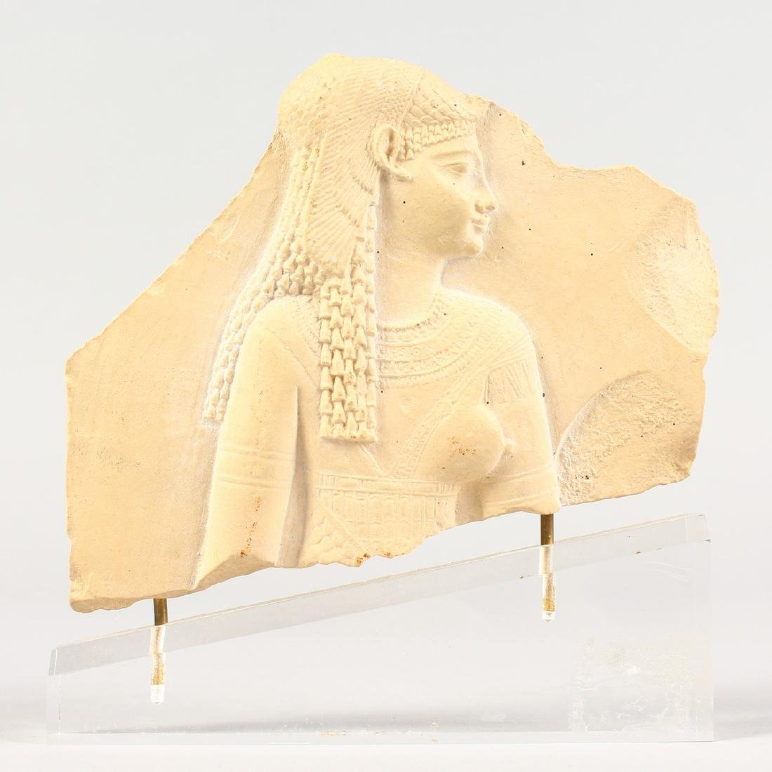 A MUSEUM COPY EGYPTIAN FRAGMENT on a Perspex base. - 2
