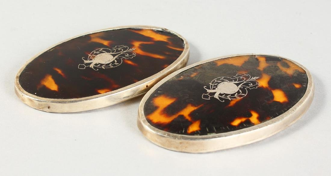 A PAIR OF SILVER MOUNTED TORTOISESHELL PLAQUES.  London
