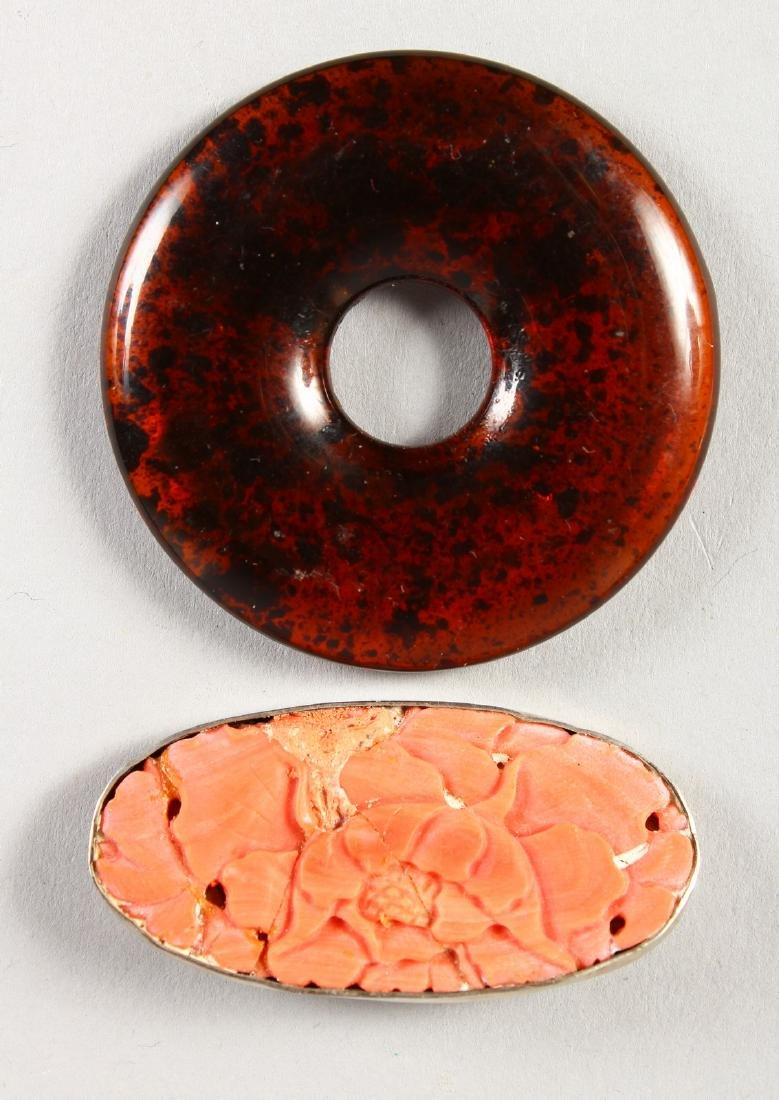 AN AMBER SPHERE and A CORAL BROOCH (2).