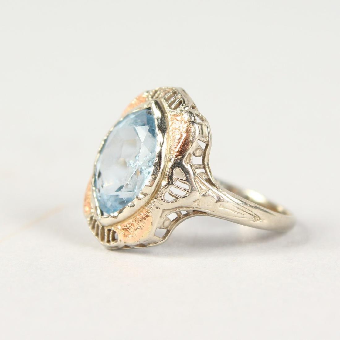 AN ART DECO WHITE GOLD DIAMOND RING.