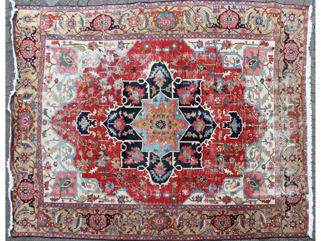 A LARGE PERSIAN CARPET with large star motif.  11ft