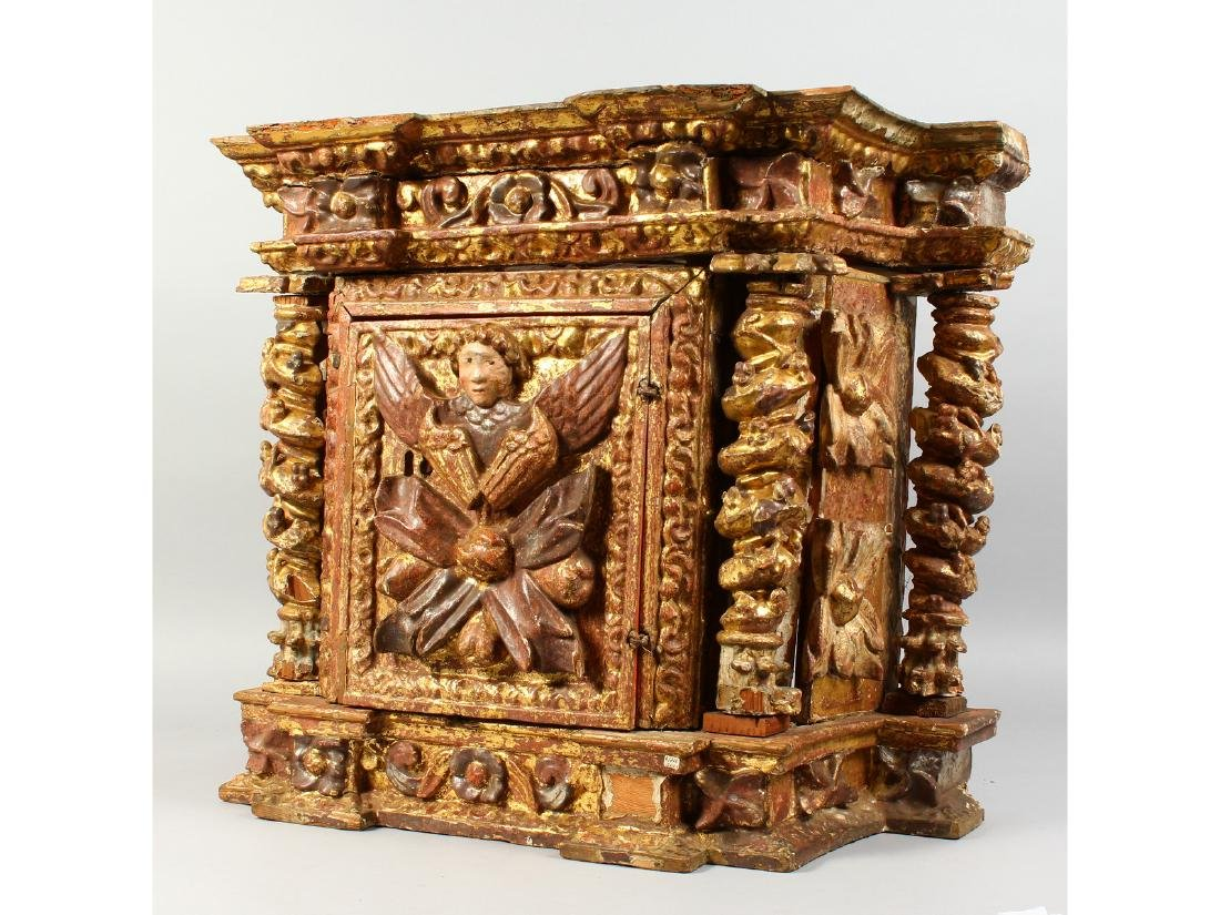 AN 18TH CENTURY ITALIAN RELIQUARY CABINET, carved with