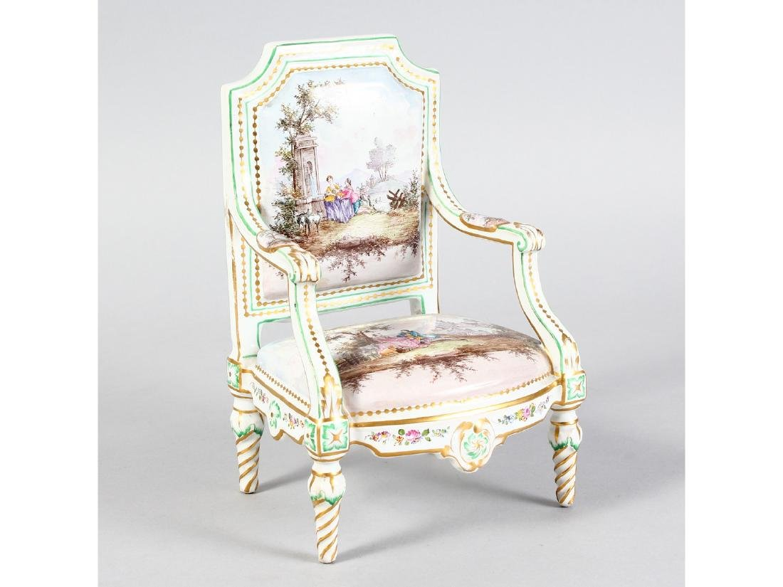 A FRENCH PORCELAIN ARMCHAIR, painted in pink with young