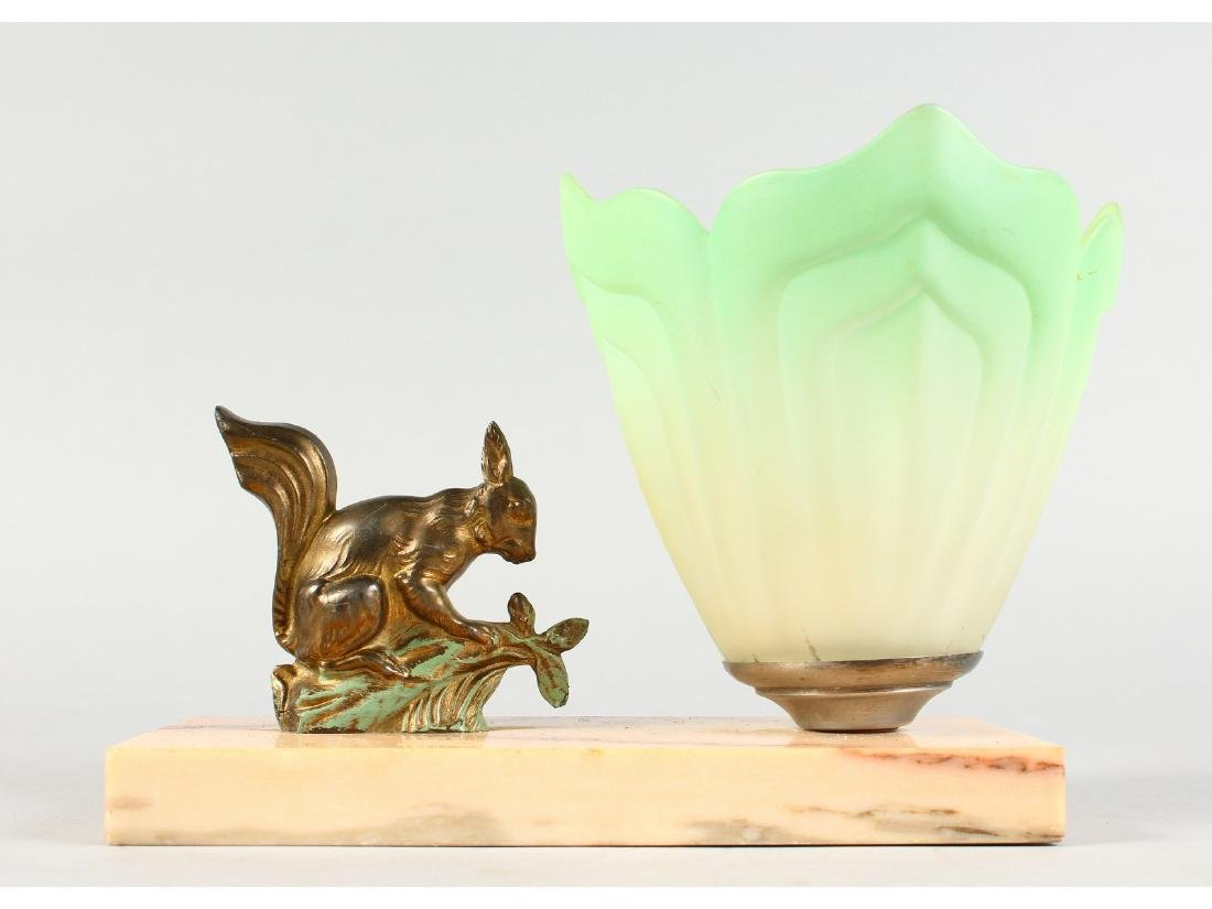 AN ART DECO LAMP, SQUIRREL ON A MARBLE BASE with green