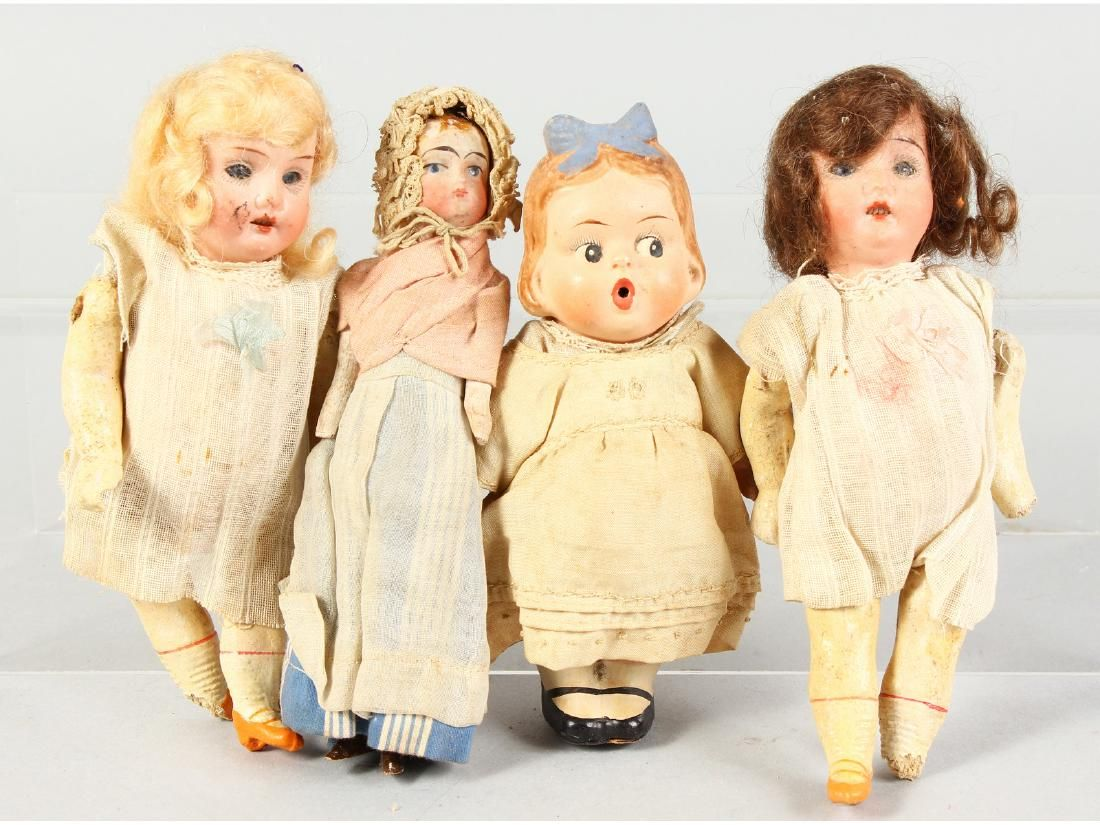 FOUR SMALL BISQUE HEADED DOLLS.