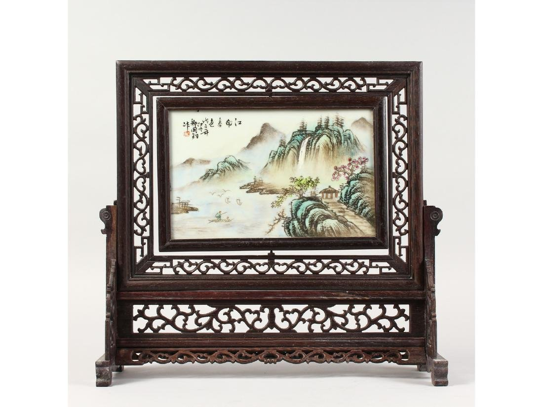 A CHINESE PORCELAIN SCREEN ON A STAND.