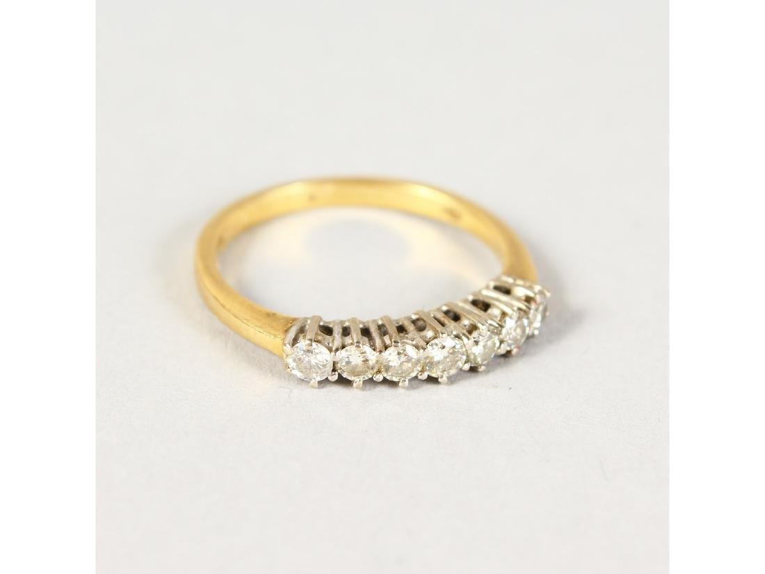AN 18CT GOLD SEVEN-STONE DIAMOND RING.