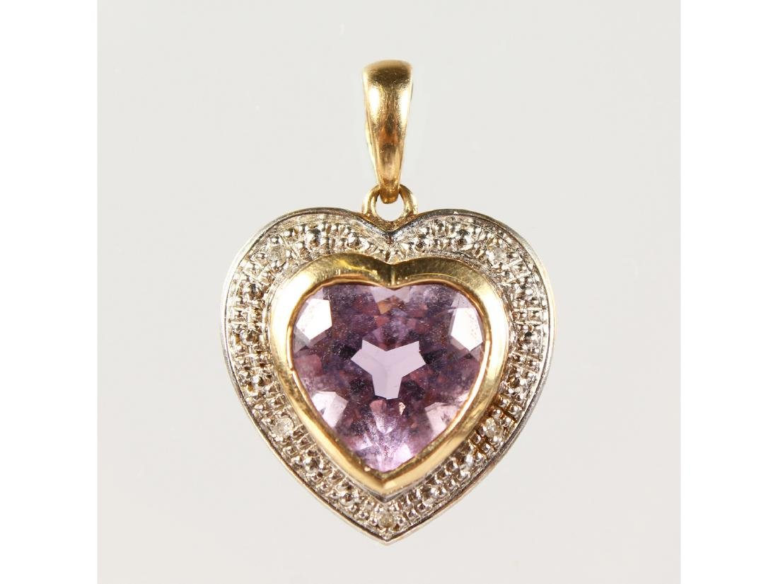 AN 18CT GOLD HEART SHAPED PENDANT.