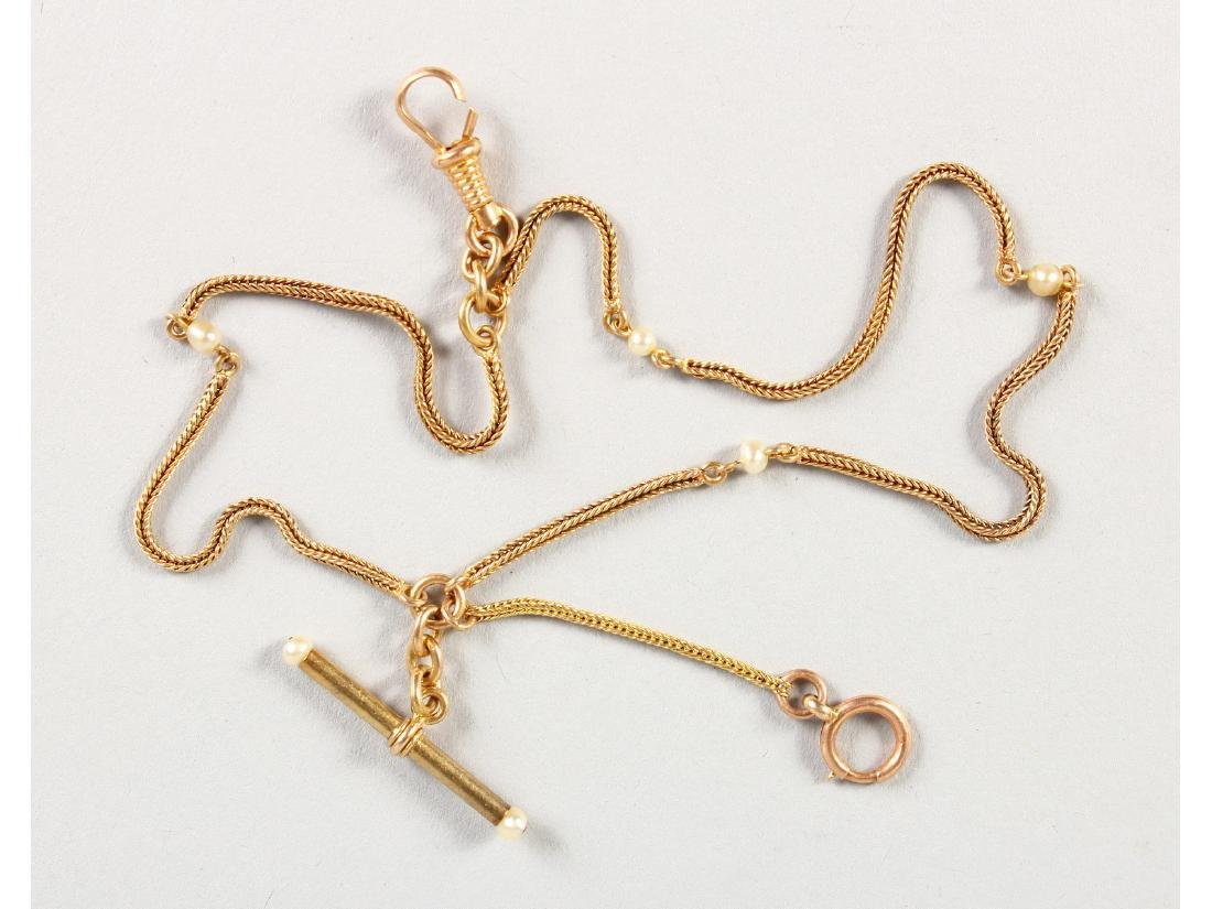A LADIES 15CT GOLD FOB WATCH CHAIN.