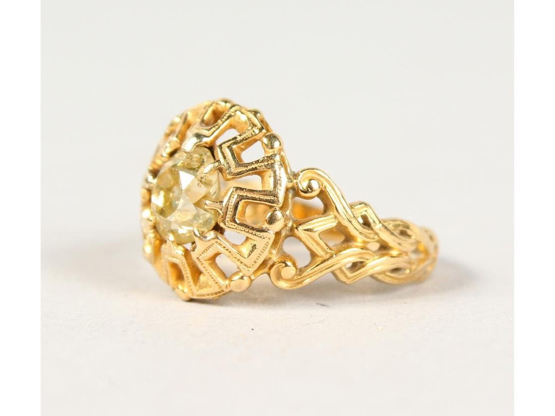 A PIERCED YELLOW GOLD AND DIAMOND SET RING.