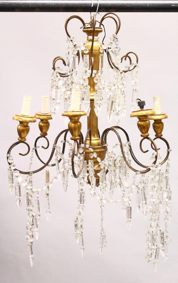 A GILTWOOD, ORMOLU AND CUT GLASS SIX BRANCH CHANDELIER.