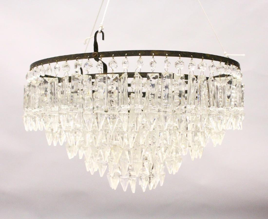 AN ORNATE CUT GLASS FIVE-TIER BAG CHANDELIER, with cut