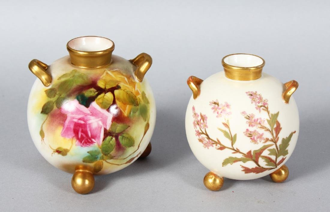 A ROYAL WORCESTER SPHERICAL TWO-HANDLED VASE on three