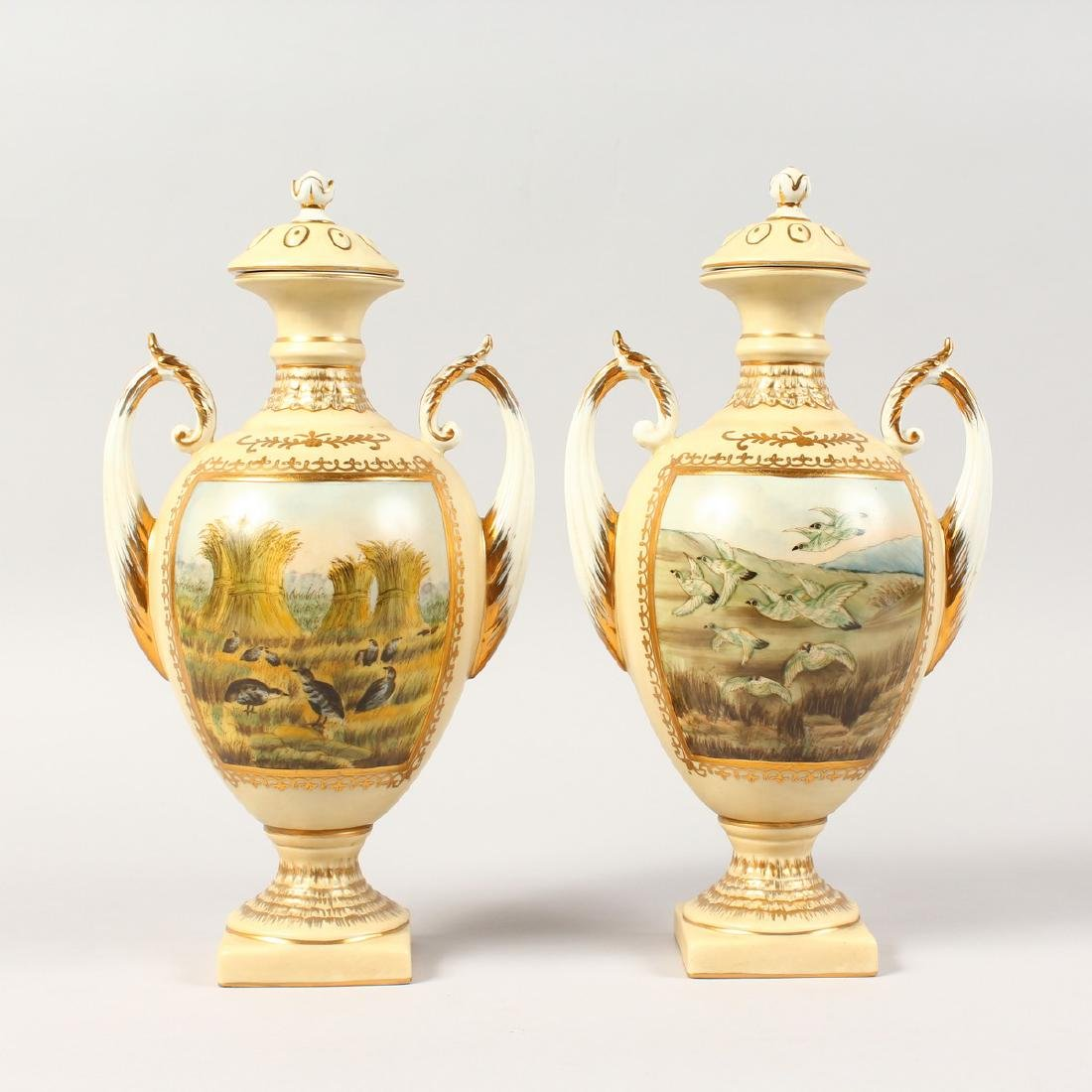 A PAIR OF CONTINENTAL PORCELAIN TWIN-HANDLED VASES AND