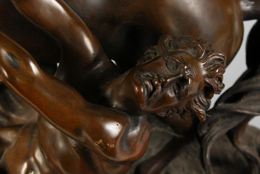 A LARGE BRONZE GROUP OF A YOUNG MAN TRYING TO RESTRAIN - 4