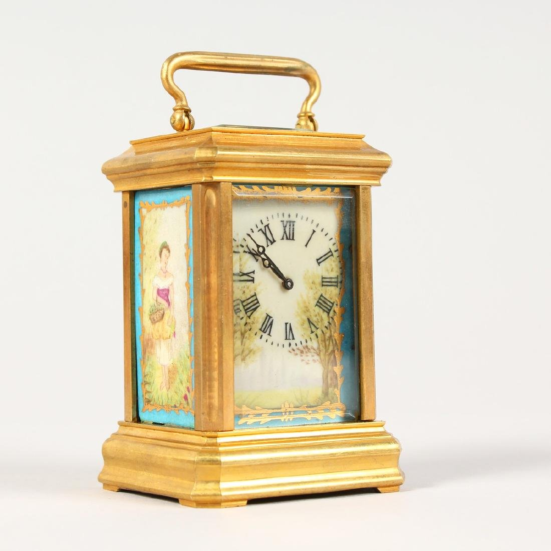 A SEVRES STYLE MINIATURE CARRIAGE CLOCK, with porcelain