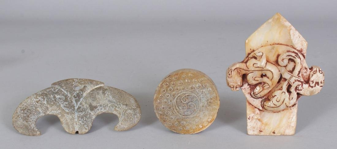 A GROUP OF THREE ARCHAIC STYLE JADE-LIKE CARVINGS, the